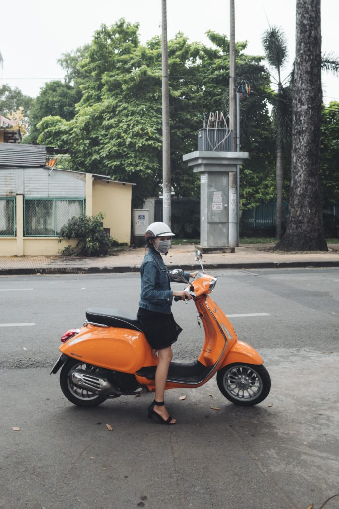 Girl on scooter in ho chi minh vietnam