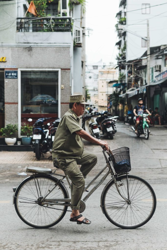 Man on bicycle in ho chi minh Vietnam