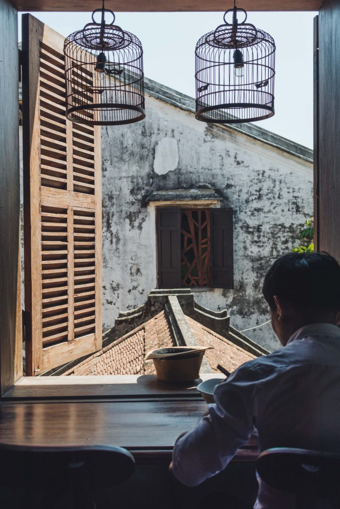 man having a morning coffee in hoi an