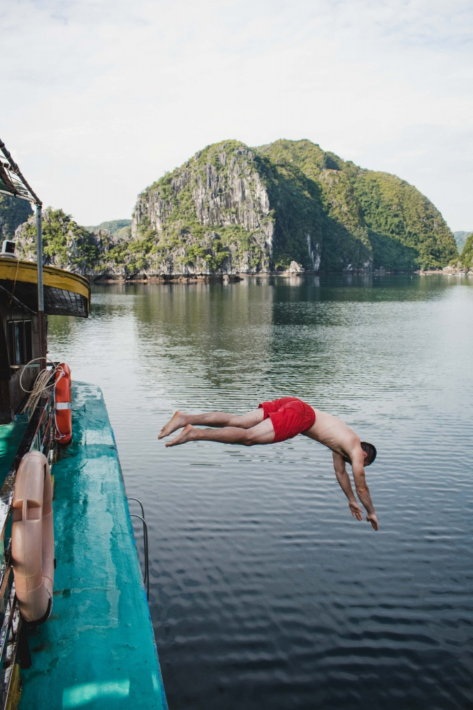 diving off the deck into Lan Ha Bay