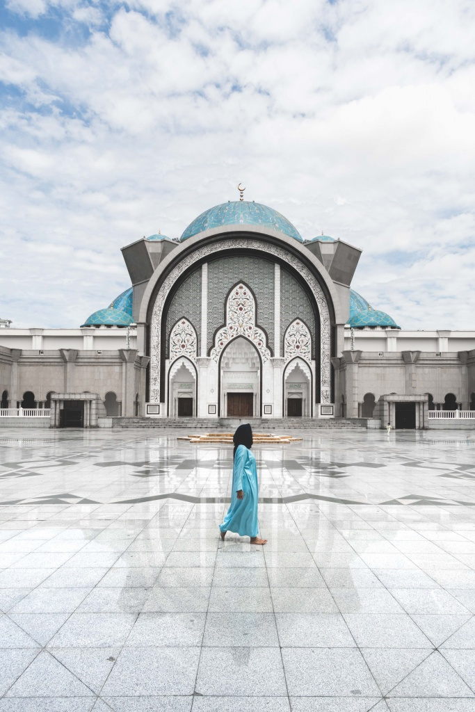 Posing in front of the federal territory mosque in Kuala Lumpur
