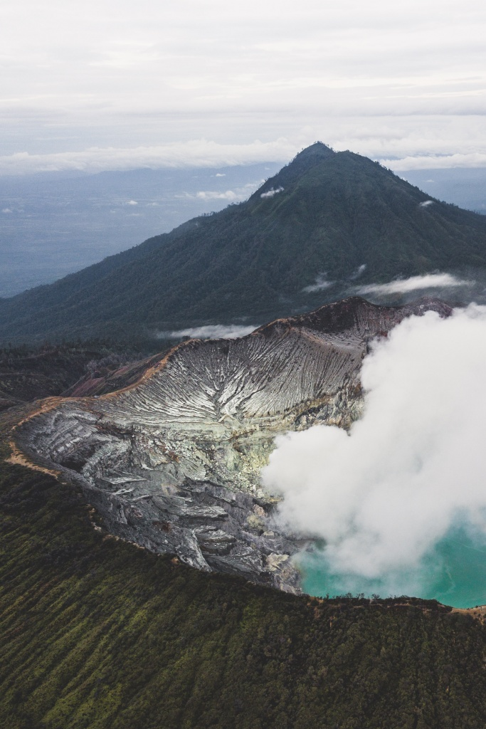 drone photography ijen crater volcano with acid blue lake