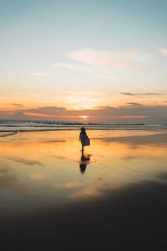 girl at sunset at pasut beach in Bali indonesia
