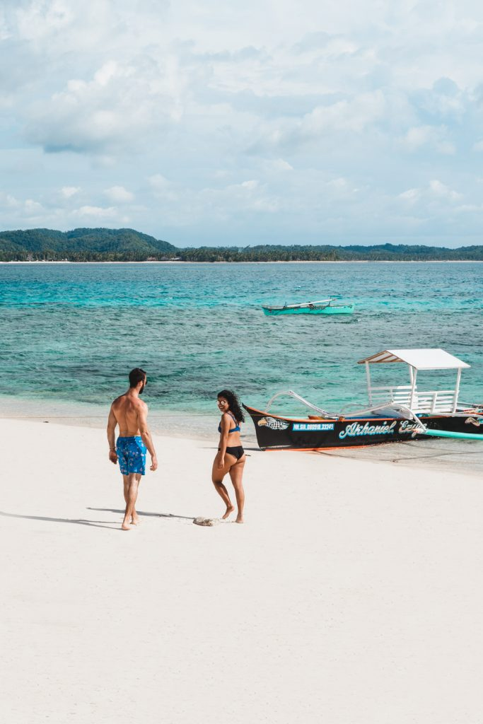couple on naked island siargao in the philippines
