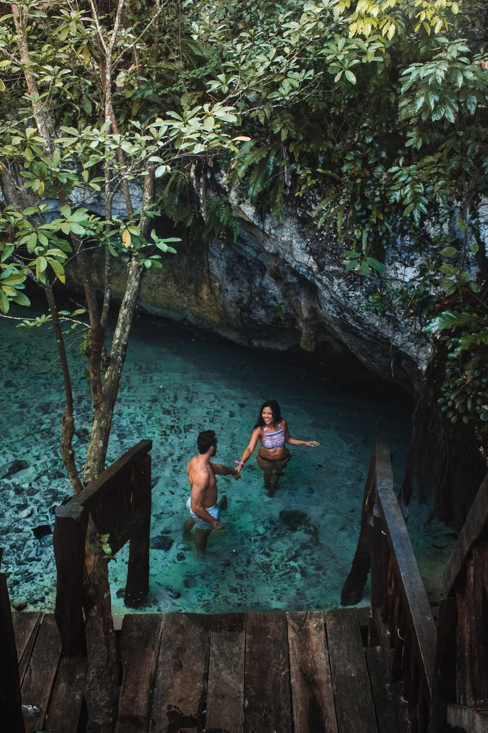 couple at the grand cenote in tulum mexico