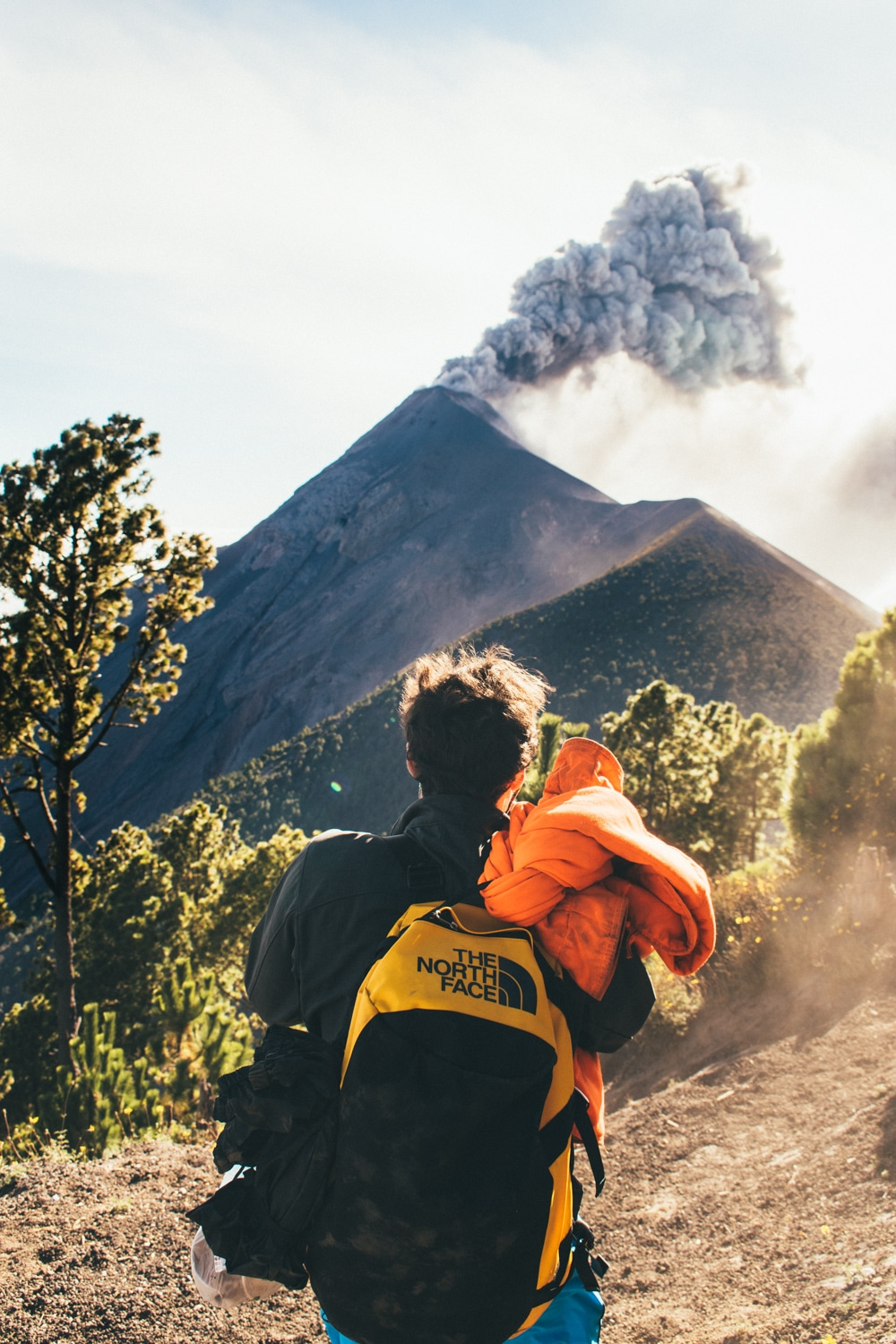 hiker in front of volcan fuego guatemala