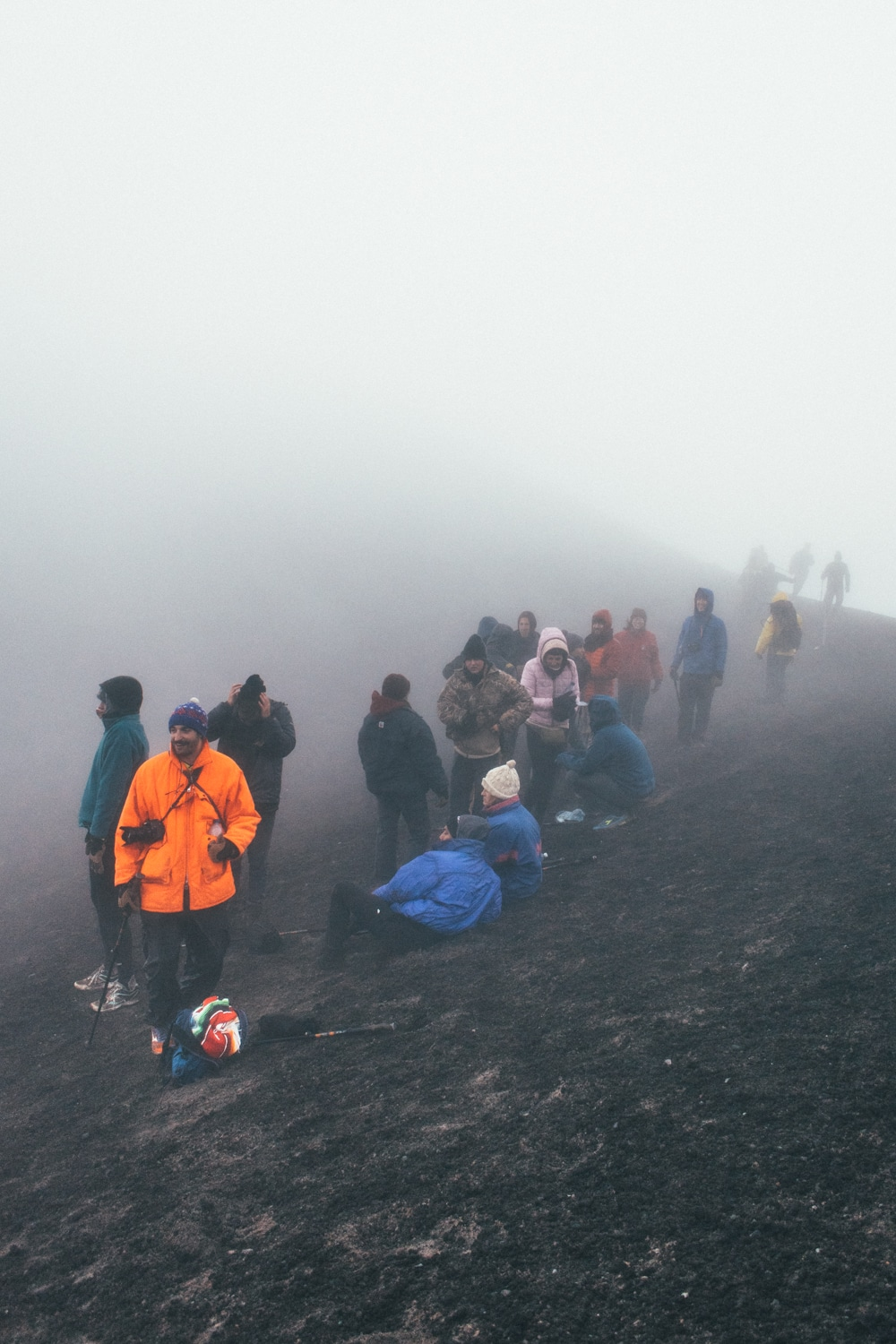 hikers at the summit of the Acatenango volcano