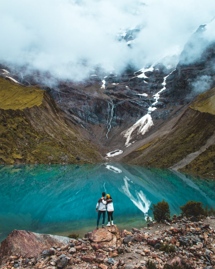 couple posing at humantay lake in peru
