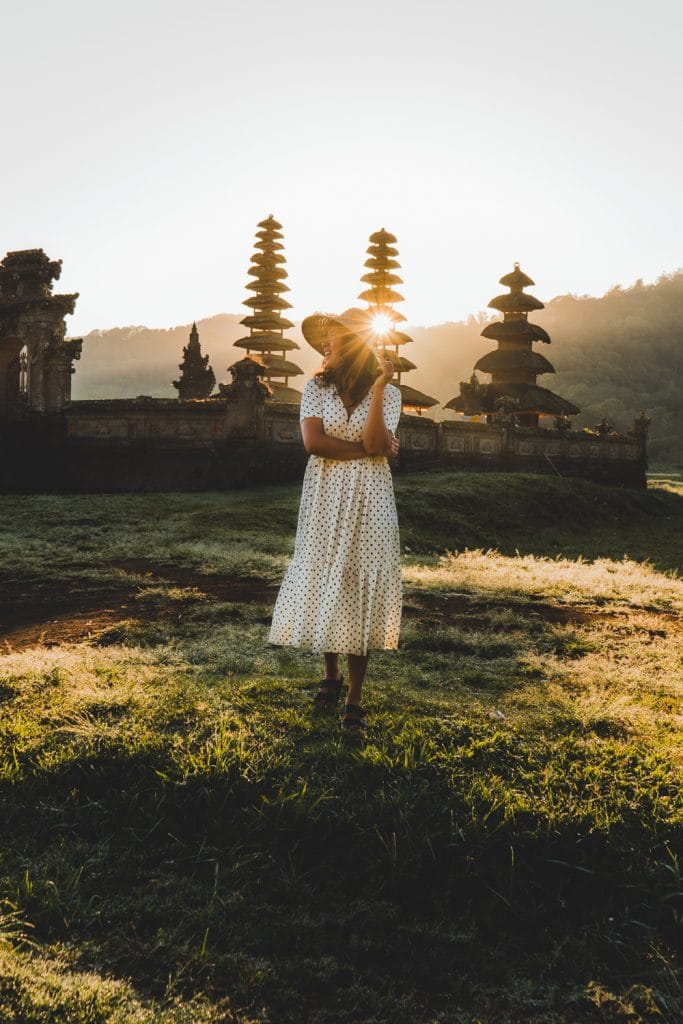Sunrise over temblingan water temple in bali