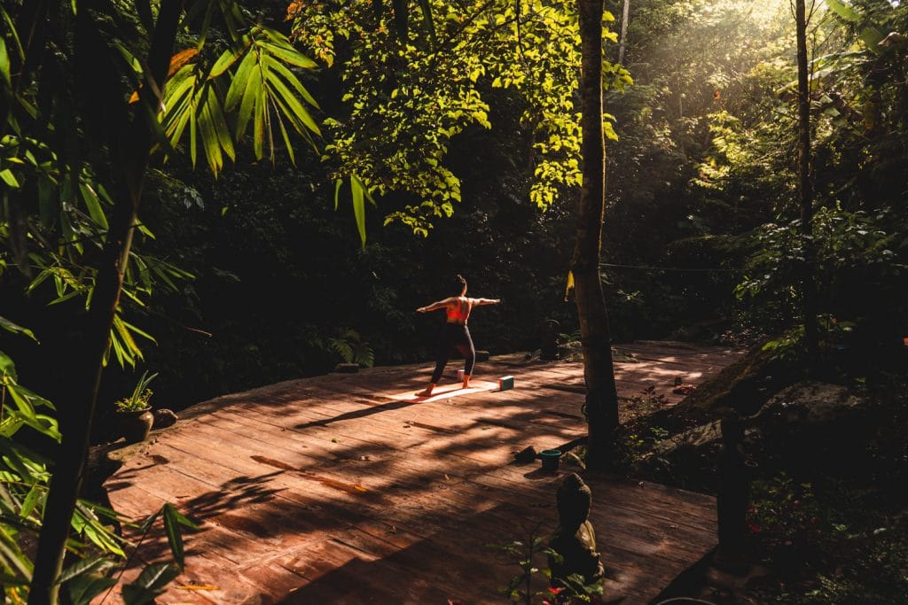 practicing yoga in the jungle in munduk bali at ekommunity