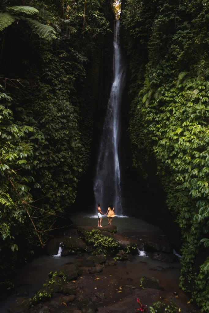 couple at leke leke waterfall in bali