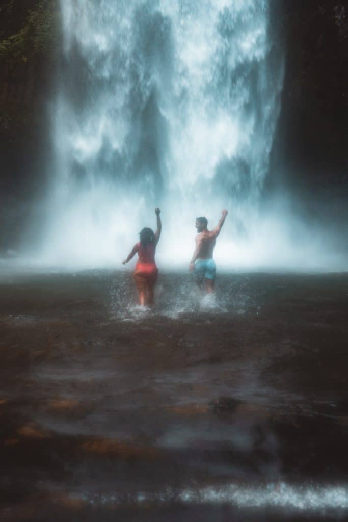 swimming in nungnung waterfall the best waterfall in bali