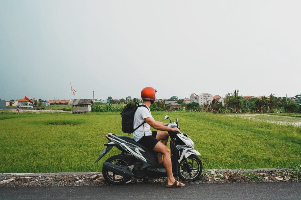 driving a scooter in bali to nungnung waterfall